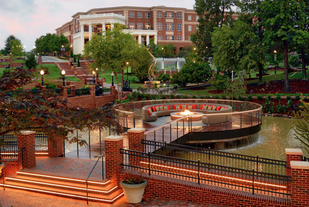 Pedestrian bridge to fire pit seating area over waterfall